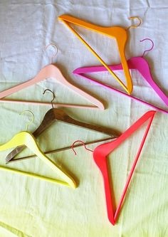 I came across this bright idea by Design Love Fest as I was browsing Pinterest instead of, well working on my original post. Distractions happen. The colorful hangers were, in fact, simply a prop in a post on how to take better pictures, but it's an idea that's totally worth stealing.