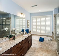 This master bathroom features dual vanities and custom cabinetry. The Peyton - Plan 1289. http://www.dongardner.com/house-plan/1289/the-peyton. #MasterBathroom #HomePlan #Design