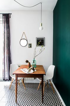 Small dining area with bright colorful wall | #connox #beunique