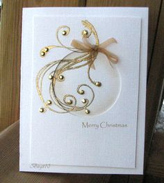 By Birgit Edblom (Biggan at Splitcoaststampers). Negative circle die-cut linen panel attached to card base. Spong inside circle near the edges. Stamp a swirl & heat emboss it with gold. Add gold rhinestones & a bow. What a great idea! Homemade Christmas Cards, Christmas Cards To Make, Xmas Cards, Homemade Cards, Handmade Christmas, Holiday Cards, Christmas Crafts, Merry Christmas, Elegant Christmas