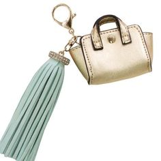 Gold Mini Bag Faux Suede Mint Tassel Bag Charm Fashion forward trendy key item for this spring and summer 2016. The bag charm trend is only going to increase in popularity. It is said that the bag accessory industry is going to grow to a 20 billion dollar industry and this is the item to follow that trend with as a start :) Brand New with tags, Never worn and a perfect gift for yourself or someone else. Melie Bianco Bags Mini Bags