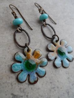 Gorgeous enameled copper charms, handcrafted by Marlene Kazor Quigley, are perfectly paired together with mini lampwork beads, handcrafted by Susan