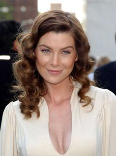 Grey's Anatomy star Ellen Pompeo modeled a fresh look with wavy chestnut hair and a deep side part at NBC Upfront.