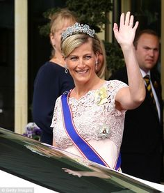 Sophie, Countess of Wessex, waves to the crowds in Stockholm. wearing a floor length column dress in pale pink June 8, 2013