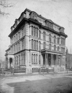 Boys High School, later Male High School, at the corner of Brook Street and Breckinridge Street, Louisville, Kentucky. Four-story building with front entrance pillars and also a small side porch. There are pediments over the top floor's windows, grouped in three clusters of two or three. The school was established in 1856 and claims to be the oldest public high school west of the Allegheny Mountains. Louisville Male High School moved to the Brook and Breckenridge location in 1915 and moved to a