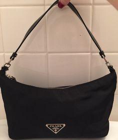A personal favorite from my Etsy shop https://www.etsy.com/listing/481131715/vintage-black-prada-hobo-handbag-milano