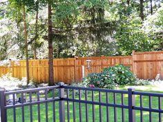 6' High Cedar wood privacy fence with ornamental aluminum fence.