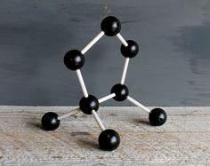 Try a vintage molecule model as conceptual tabletop art. #etsy