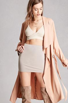 A sheeny stretch-knit mini skirt featuring an elasticized waistband and a bodycon silhouette. This is an independent brand and not a Forever 21 branded item.