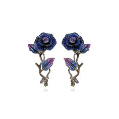 LYDIA COURTEILLE SECRET GARDEN EARRINGS £19,000 Black rhodium plated textured stems interweave with royal blue and purple sapphire leaves that trail up to blossoming flowers Height (mm) : 50 Width (mm) : 26