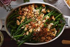 Green beans get a French-inspired makeover in this delicious side dish. Serve it with Thanksgiving turkey for a fast and satisfying side or toss it together for an elevated weeknight treat! Recipe: French Green Beans and Garlicky Almond Breadcrumbs   - CountryLiving.com