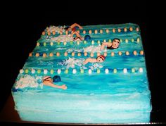 """10"""" square cake with buttercream and blue piping gell. the floats are pieces of candy necklace and the swimmers are made of gumpaste with painted on details."""