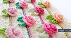 Take your crocheting projects to the next level with this gorgeous crocheted rosebud stitch. This amazing crochet stitch makes 3D rosebuds.