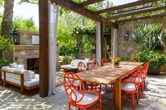 Great outdoor space w curtains, fireplace, plantings...