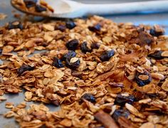Spiced cherry almond granola with dried cherries, almonds and coconut is spiced with cinnamon and cardamom. A healthy breakfast at a fraction of the cost!
