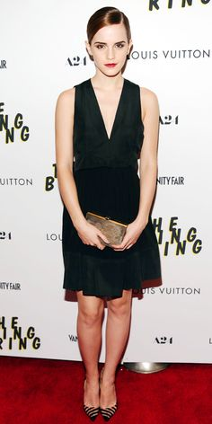 06/12/13: At The Bling Ring screening, Emma Watson elevated her classic LBD with a gold clutch and striped Christian Louboutin pointy-toe pumps. #lookoftheday