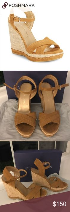Stuart Weitzman Elevate Open Toe Wedge Camel sz 8 Near perfect condition - only worn 2 times.  Purchased at Saks Fifth Avenue for $435.  Original box and dust bag.  I simply have too many pairs of Stuart Weitzman wedges!  Size 8 and true to size.  The upper and the outsole are man made.  The lining is leather.  4 inch wedge heel but very stable.  Ankle strap with adjustable buckle closure. Stuart Weitzman Shoes Wedges