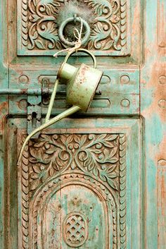 patina in turquoise  The colour is incredible and happens to be my favourite but the little oil can? knocker is, well who thought of that...brilliant.