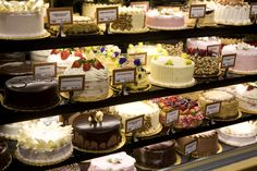 marvelously various shelves of cake shop cakes