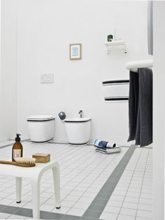 Amazing Black And White Bathroom Ideas Inspirations With A Touch Of Retro Charm With White wc and bidet with black edges and matching floating Grey Towel White Table