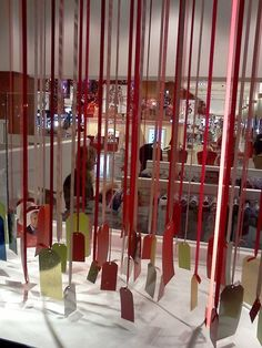Hanging ribbons with Price TAGS window display that is a fantastic idea for your holiday booth. Christmas Window Display Retail, Store Window Displays, Retail Displays, Display Windows, Holiday Store, Christmas Store, Xmas, Retail Windows, Store Windows