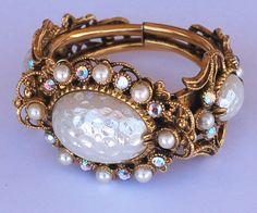 Selro Ornate Rhinestone Pearl Cuff Bracelet by EmbellishgirlVintage on Etsy https://www.etsy.com/listing/225892631/selro-ornate-rhinestone-pearl-cuff