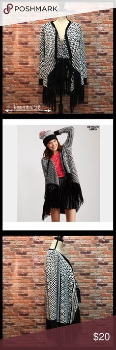 """Bethany Mota Fringed Open Front Cardigan Bethany Mota fringed open front cardigan in a size XS.  Has a foldback cascading open front.  Fringe down either side of the front and all along the hem.  Black trim around the neckline, sides, the cuffs, and the hem.  Measures approximately 20"""" armpit to armpit, see photo.  28"""" in length before the fringe and 33"""" in length with the fringe.  100% acrylic.  In excellent condition. Bethany Mota Sweaters Cardigans"""