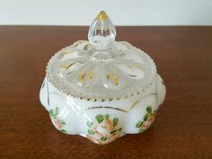 Check out this item in my Etsy shop https://www.etsy.com/listing/259560258/vintage-fenton-tyndale-powder-jartrinket