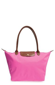 Longchamp 'Large Le Pliage' Tote at Nordstrom.com. A customer-favorite, water-resistant nylon tote is offered in a range of colors, each trimmed with embossed leather for classic contrast. This version is a new, trimmed-down size with a shorter, more elegant strap drop.