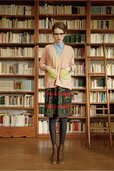 ok, lose the glasses and the cardigan--- I like the skirt, tights, and boots