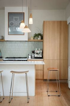 backsplash, white island with wood cabinets behind, pendants. I love it all!