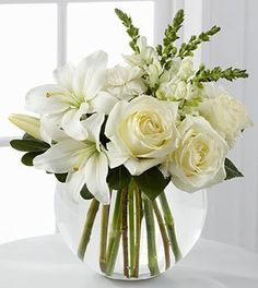 The FTD® Special Blessings™ Bouquet is a brilliantly beautiful arrangement to bring peace and comfort to your friends and family in their time of need. White roses, Asiatic lilies, snapdragons and car More