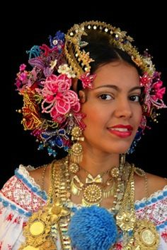 Woman in traditional dress from Panama - I love the idea of using beaded flowers rather than the usual silk flower 'hair garden' that most tribal dancers wear.