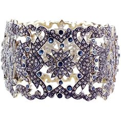 Gorgeous Victorian style bangle bracelet encrusted with diamonds and blue sapphires. Etsy - $10,584.