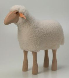 Beautifully made wooden sheep with real soft, sheepskin. The sheep are strong enough to be used as stools. Made with beech legs, leather ears and sheep skin coat.<br><br>H45cm tall.