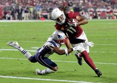 Arizona Cardinals wide receiver Larry Fitzgerald (11) scores a touchdown as New…