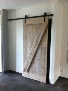 Mooie houten loftdeur
