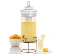Citrus Champagne Punch    2/3 C. fresh lemon juice    2/3 C. superfine sugar    1 C. Vodka (not lemon infused)    2 tsps. Vermouth    1 bottle chilled dry Champagne    Lemon twists for garnish