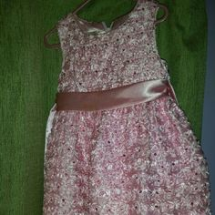 Pink special occasion sleeveless dress 3t Pink special occasion sleeveless dress 3t empire waist dress. There are signs of wear on the ribbon view pics  WILL SHIP SOONER THAN 3 DAYS! USUALLY SHIP BY THE SECOND DAY! JUST COVERING MYSELF FOR EXTENUATING CIRCUMSTANCES! :)  MAKE REASONABLR OFFERS :) I WILL CONSIDER BUNDLING TOO! FOR SHIPPING DISCOUNTS! Dresses