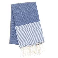 """Carathage collection in dark blue with thin white stripes. 100% Natural cotton, lightweight, over sized, soft, resistant to color fading. Can be used as a beach towel, beach wrap, bath towel, sofa throw, picnic blanket, table cloth, or patio accessory. 78""""x39"""", wash in cold water and tumble dry low twice before first use."""