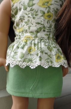 What a romantic outfit! The top is made of a pale green and yellow rose print woven cotton. Its bodice is lined, and it closes in the back with Velcro. It is trimmed at the hemline with handmade lace. The mini skirt has topstitching detail in front. I made the top and shorts in my smoke-free home. Exposed seams have been zigzagged for durability.  I am a Liberty Jane partner; I used the peplum top and mini skirt patterns to make this outfit, available at Pixie Faire.