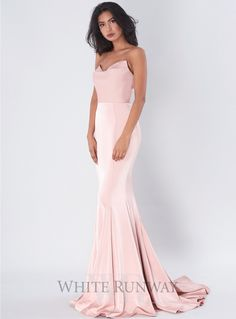 Lawrence Gown. A gorgeous full length dress by Jadore. A sweetheart neckline style featuring scooped overlay on the bust and floor sweeping train.