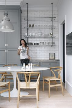 gray & white kitchen | open shelving | glass & chrome | marble | wishbone chairs