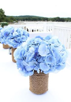 Blue Wedding Flowers Blue faux hydrangeas make stunning wedding centerpieces. Perfect for nautical weddings too. Bring in your something blue with blue wedding flowers. Beach Theme Centerpieces, Nautical Centerpiece, Diy Wedding Decorations, Blue Flower Centerpieces, Centerpiece Ideas, Wedding Ideas, Beach Centerpiece Wedding, Flowers Decoration, Table Decorations