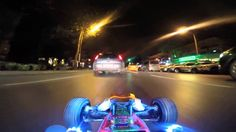 DRIVING A RC CAR AT NIGHT IN REAL CAR TRAFFIC (Contact licensing@viralhog.com for licensing/usage info.) The remote control car is being driven from the car coming behind, alongside real automobiles on a well-lit street. The camera is mounted on the RC car itself, providing a cool POV.  See also https://www.youtube.   #VIDEO2D #VIRALVIDEO