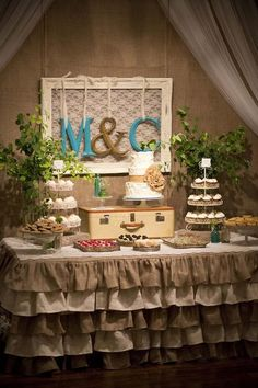 Love this! The ruffled table skirt, the initials, the vintage feel. @ wish-upon-a-weddingwish-upon-a-wedding