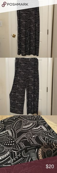 Black and white palazzo pants Black and white palazzo pants. Feels great on and very comfortable. Ashley Stewart Pants Wide Leg