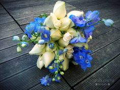 White Roses and Blue Delphiniums bouquet. www.facebook.com/camilasesmabouquets