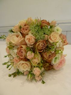 Vintage peach bouquet including roses, ammi and wax flower