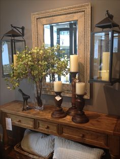 Love the hanging lanterns! Would love to combine it with the mirrored trays over the entry way table. mirror, living rooms, entry tables, entryways, foyer, hanging lantern tall candles, front entry, hang lantern, pottery barn